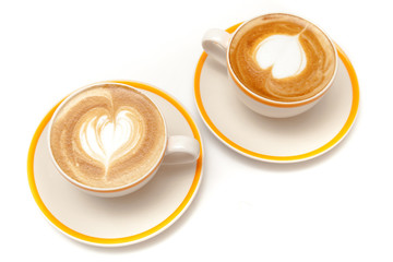 Wall Mural - Coffee cups of latte art heart shape on white background isolated