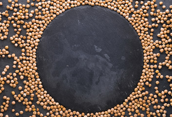 Frame of dried chickpeas on a dark surface