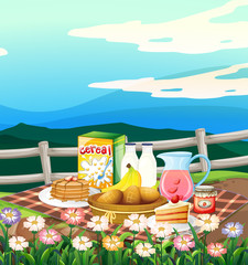 Scene with breakfast set on picnic cloth