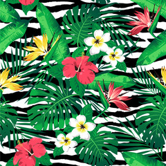 Tropical flowers and leaves on zebra striped background. Seamless. Vector.