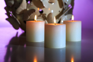 lighted candles on a beautiful background