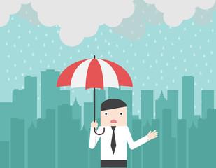 Businessman with umbrella under the rain. Big city silhouette on the background. Monsoon season. Rainy day. Bad moment. Vector illustration.