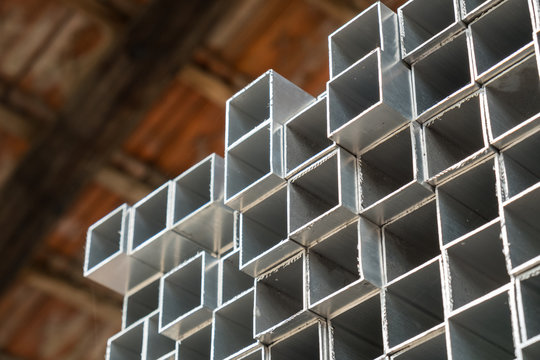 Square box aluminum profiles stacked in the warehouse