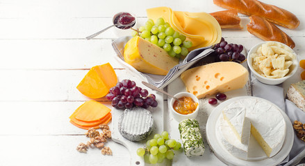 Wall Mural - Cheese plate served with grapes