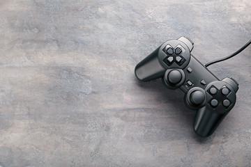 Black joystick on a grey wooden table