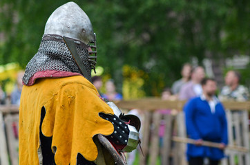 Historical restoration of knightly fights on city festival of medieval culture
