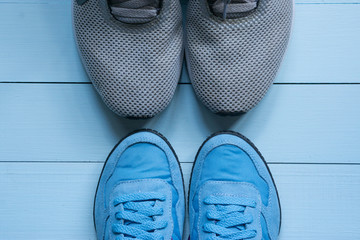 two pairs of sport sneakers toe to toe