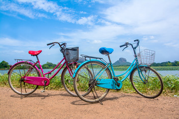 The bicycle stands on a village road at Thalkote lake near Sigiriya. Renting a bicycle and cycling around Sigiriya village is the most popular way among the tourists