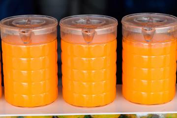 Orange juice in plastic jug in the market.Thailand.