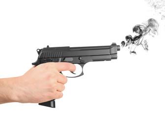 Male hand holding gun on white background