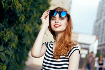 Beautiful young woman in sunglasses outdoors in the city