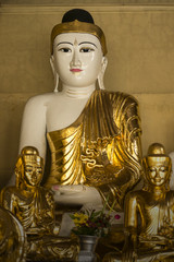 GOLDEN BUDDHA IMAGE Golden Buddha image is located peacefully in the temple.