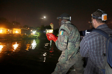 American conservation biologist and expert in crocodiles Matt Shirley instructs Ivorian rescue workers and forestry agents during a government-backed training program on how to humanely capture and relocate crocodiles in Abidjan