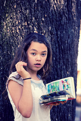 The girl at the park reads