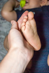 The foot of the baby in the mother's hand