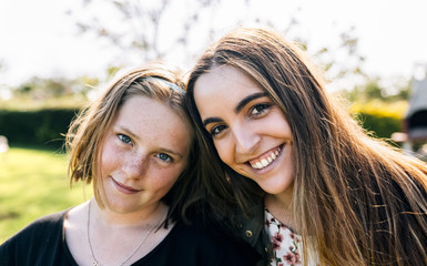 Portrait of two smiling girls outdoors