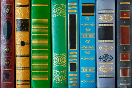 Colored books cover with patterns (closeup, texture, background)