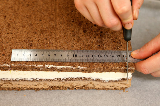 A worker cuts pieces of chocolate mousse cake at Wittamer chocolate boutique in Brussels