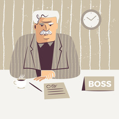 Middle-aged male boss sitting at his desk