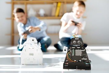 Two little friends conducting a robot race