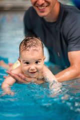 Smilling baby boy in swimming pool