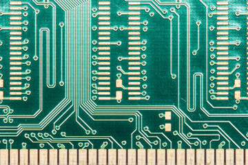 Pattern of electronic part of computer on green board in close up