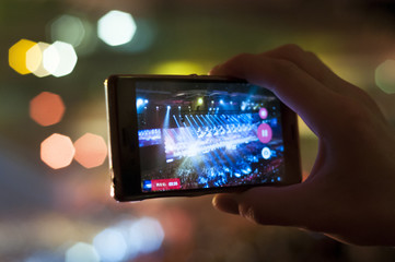Blurred background : Bokeh lighting in concert with audience ,Music showbiz concept, music performance concert with bokeh spotlight. entertainment concert lighting on stage, blurred disco party.