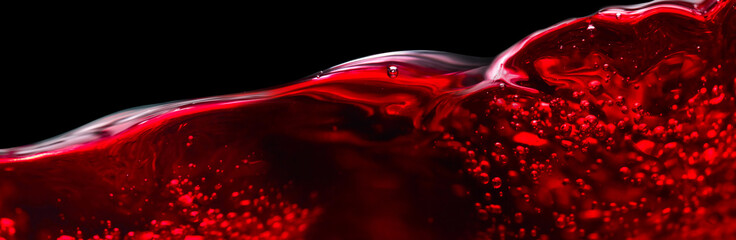 Red wine isolated on black background