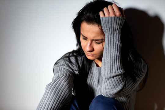 unhappy woman crying on floor