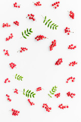 Berry theme. Red currant and leaves on white background top view copyspace
