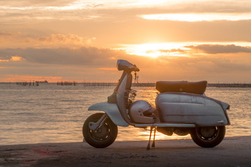 Fotorolgordijn Scooter The joy of travel rider Concept . Happy traveling on motorcycle scooter on bridge at the sea during his time at sunset - An impressive collection of romantic memories.