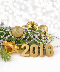 2018 year golden figures and spruce branch and Christmas decorations