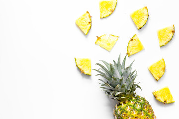Pineapple slices on white background top view