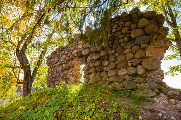 Ancient wall of castle ruins in Aluksne, Latvia. Autumn time.