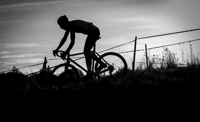 cyclocross racer silhouetted