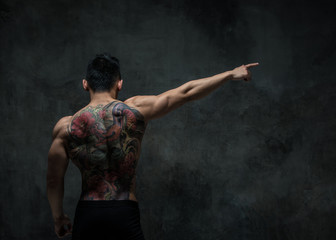 Asian model with tattoo