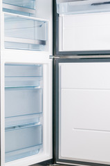 Empty fridge with open door