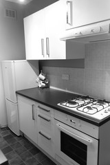 Nice kitchen in English appartment, white cabinets