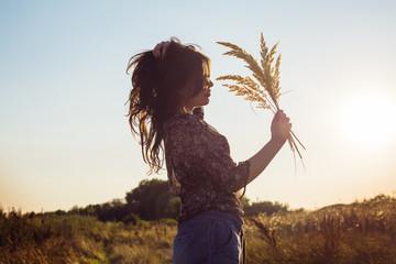Young beautiful woman enjoying day in nature