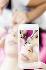 woman making selfie in beauty salon