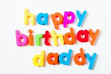 "Fridge magnets magnetic letters spelling out ""happy birthday daddy"""