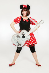 Girl in a mouse costume. The girl with a guitar. Cheerful girl. Leading children's parties.