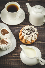 zephyr, cake in glaze and a cup of coffee with cream/zephyr, cake in glaze and a cup of coffee with cream top view