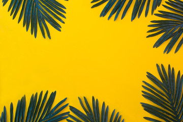 Tropical vacation and beach sand theme yellow background in pop art style with palm tree leaves