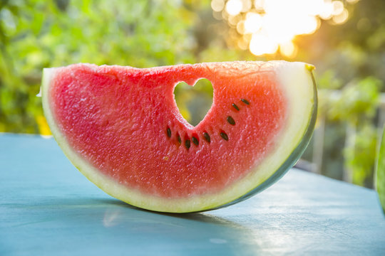 Watermelon with a heart at sunset