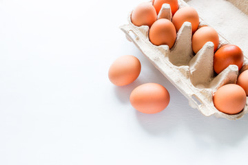 Eggs in a box on a white background with place for text
