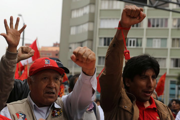 Unionized mine workers participate in an indefinite nationwide strike to protest the government's proposed labor reforms, in Lima