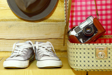 Retro travel accessories.Suitcase,camera,sneakers,hat.