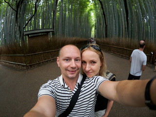 Caucasian couple in Kyoto Bamboo Forest