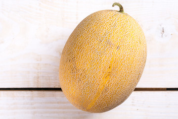 Fresh melon on the wooden board table